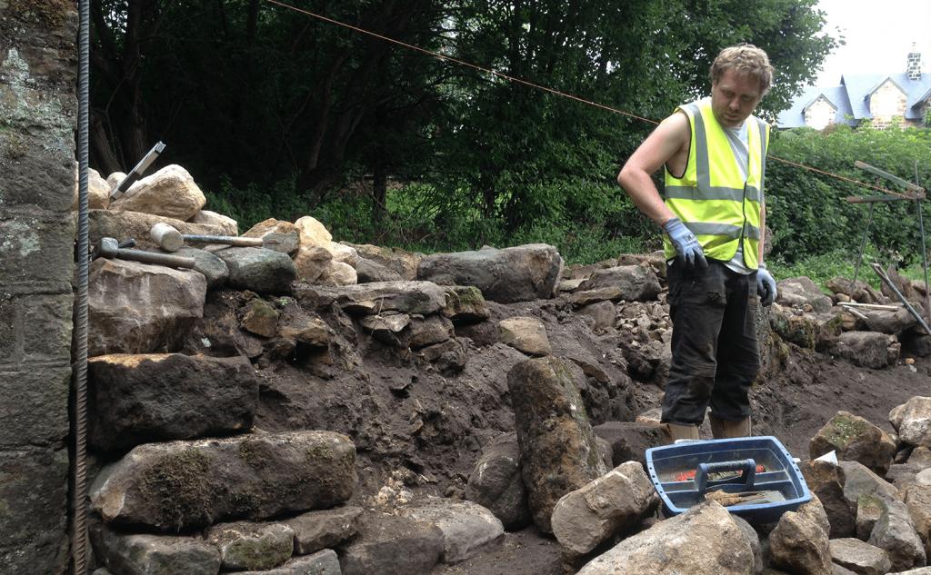 Waller selecting stone