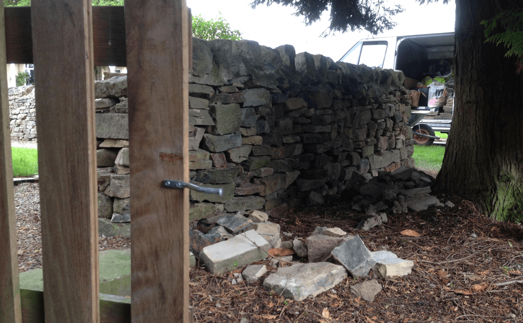 Collapsing drystone wall with mortared tops