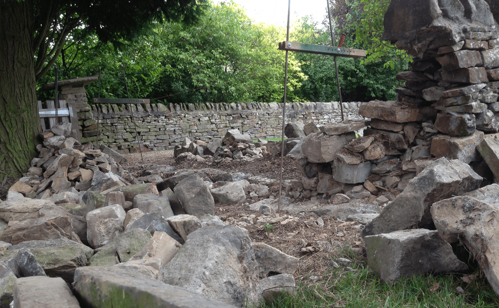 Stripped dry stone wall section