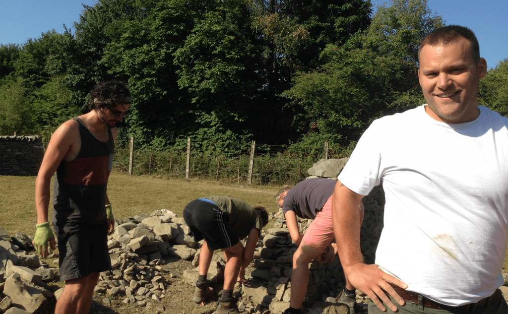 Trainees stripping dry stone wall