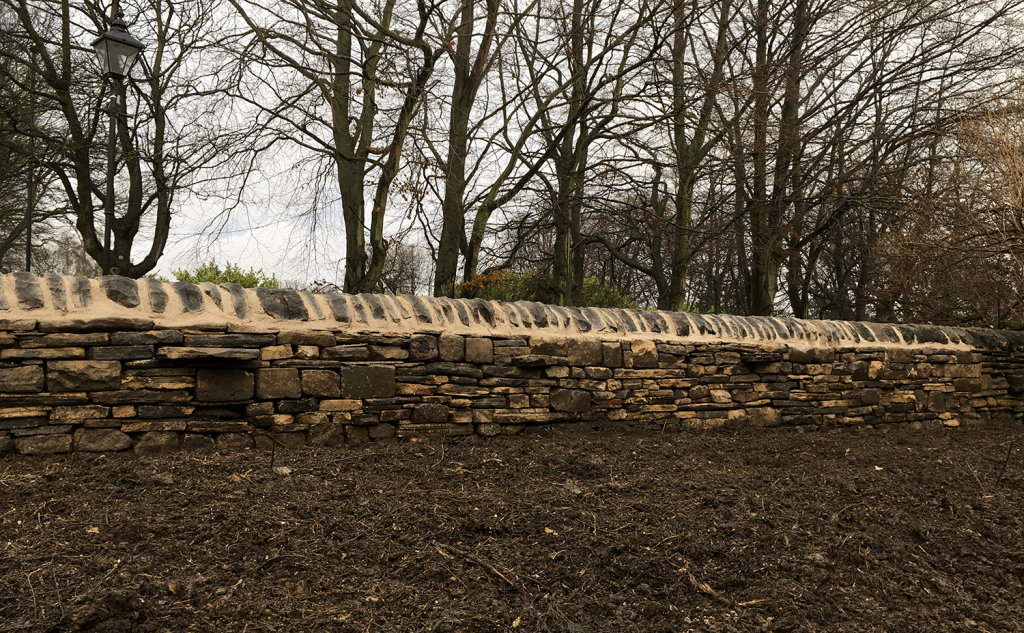 Mixed part retaining wall rebuild complete