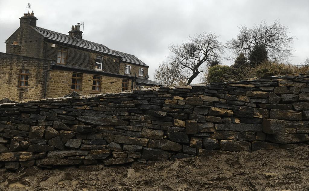 Through stones protrude on garden side