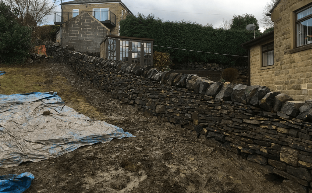 Completed dry stone wall with hedgehog smoot