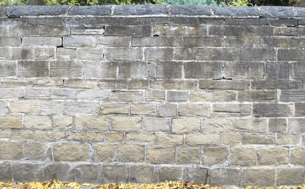 Bulged lime mortared stone wall