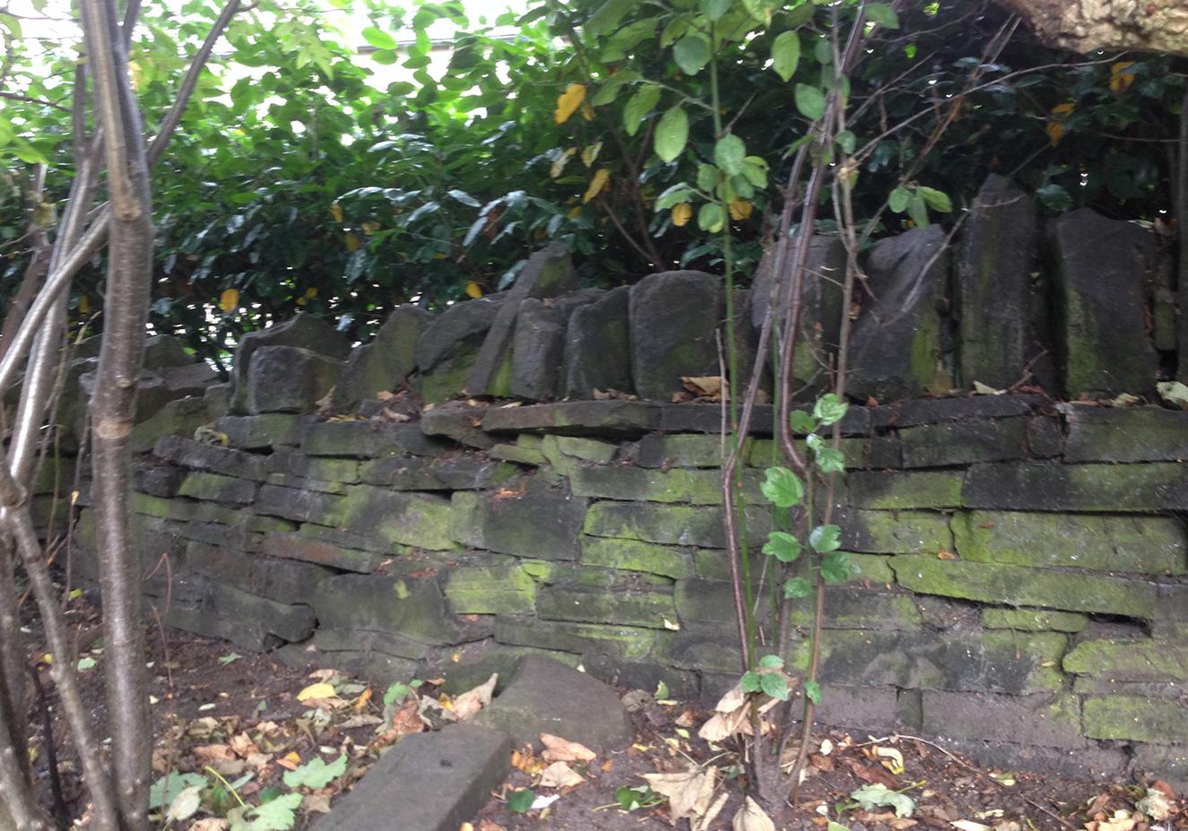 Weathered & damaged garden wall